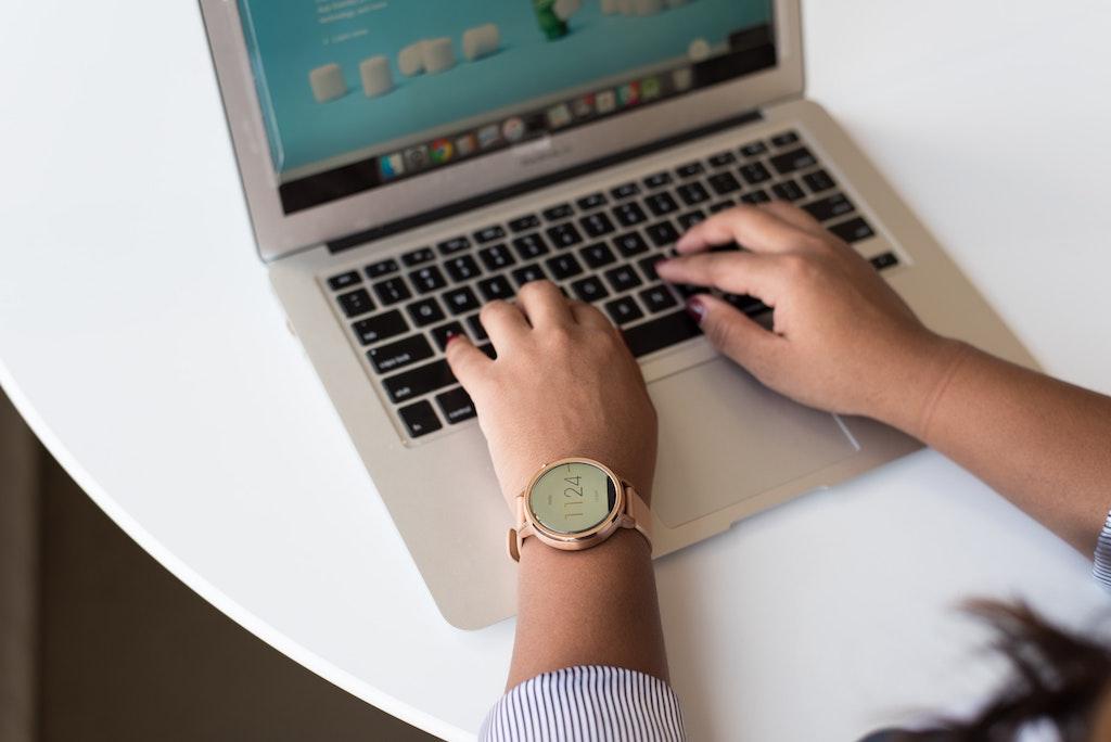womxn typing her brand messaging framework on her laptop