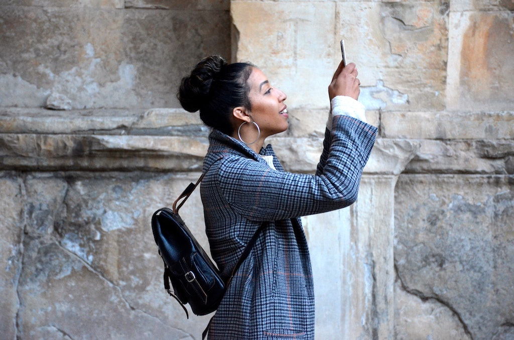 woman taking a photo with her cellphone