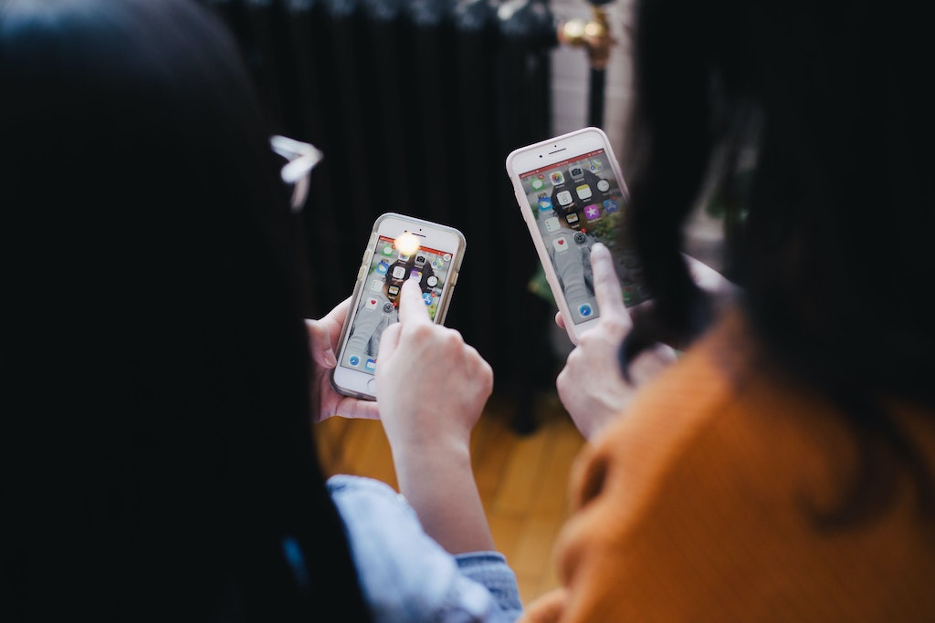 women looking at their phones